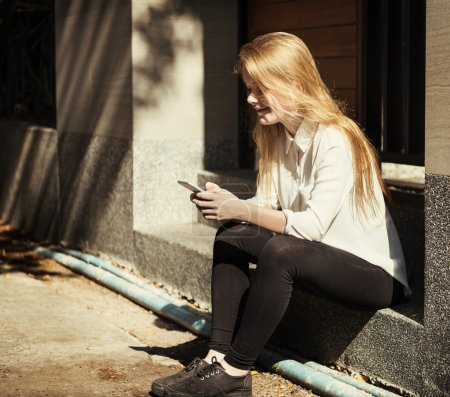 Young girl Using Smart Phone