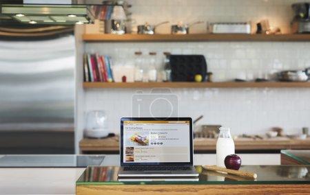 Laptop on kitchen table
