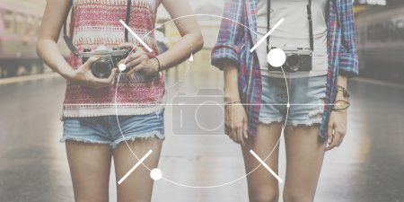 girls with cameras on background