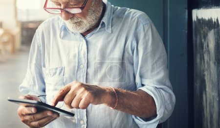 Casual Senior Man using Tablet
