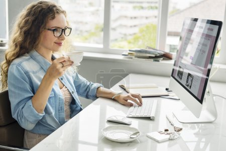 Lady working in  Office