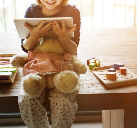 Little Girl holding digital tablet