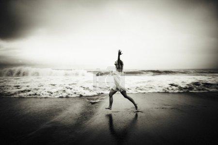 Woman runninh at ocean beach
