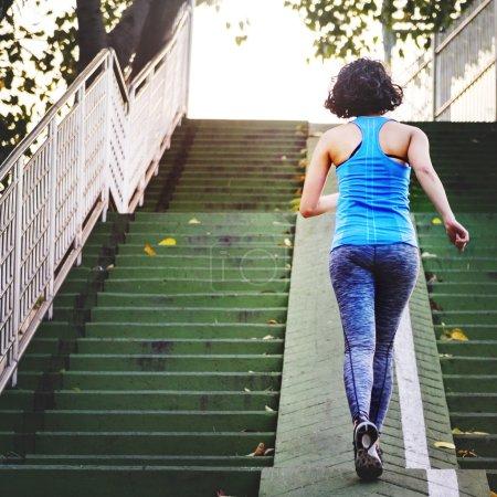 sportive woman running upstairs