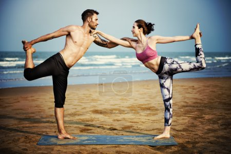 People doing sport exercises at beach