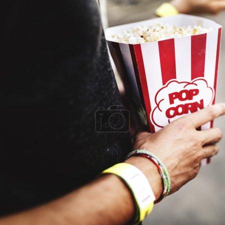 Man holding Popcorn at Movie
