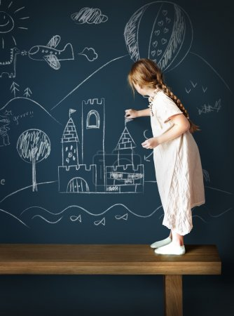 Girl drawing on Blackboard