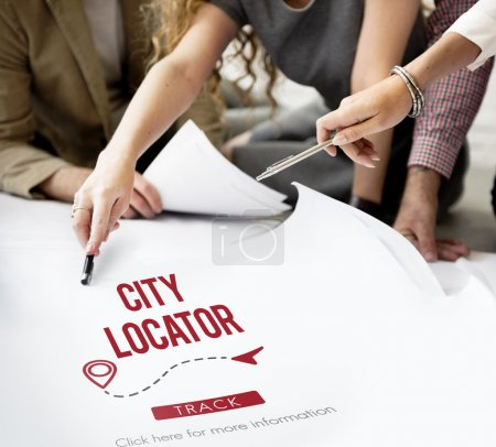 Designers working with city locator