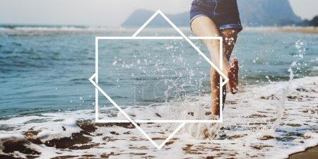 woman splashing water on beach