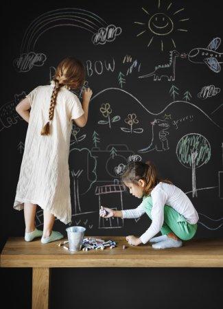 Kids drawing on blackboard