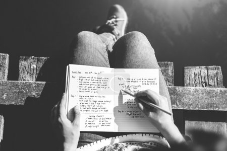 Girl making notes in diary