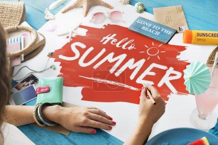 woman writing hello summer text