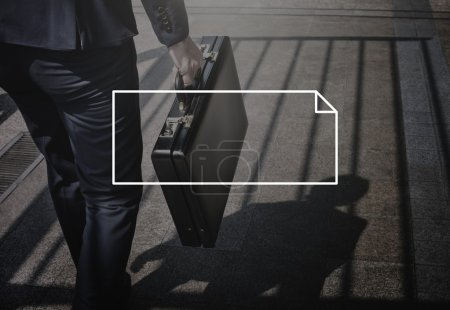 businessman walking with suitcase