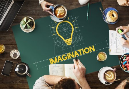 table with poster with Imagination concept