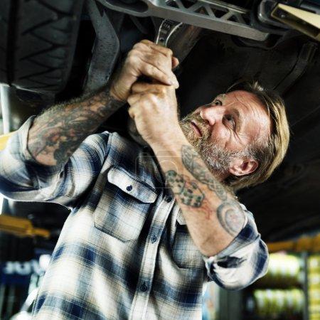 car mechanic repairing automobile