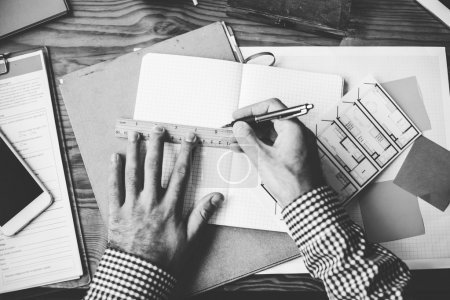 Man drawing at paper