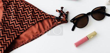 Bikini and Sunglasses with lipstick