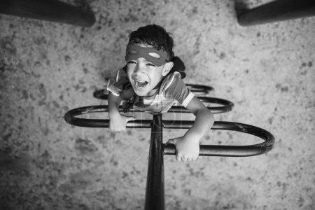 Superhero Little Boy in Playground
