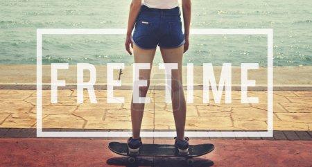 Woman in shorts riding Skateboard