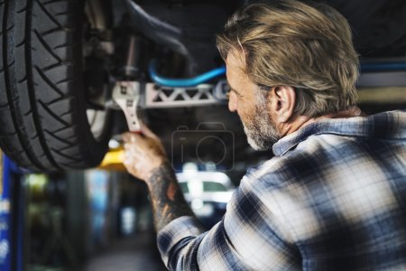 man mechanic repairing car