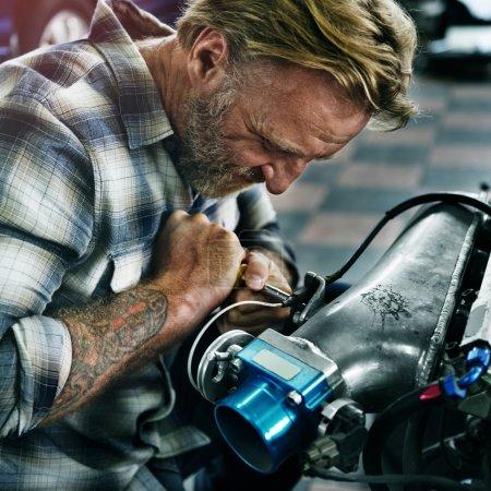 man mechanic repairing car