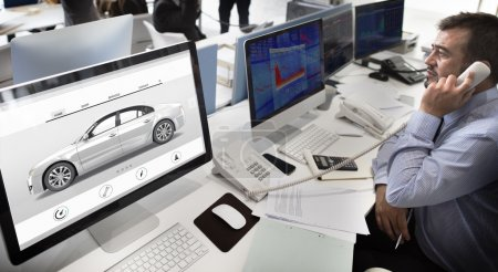 businessman working on computer with car