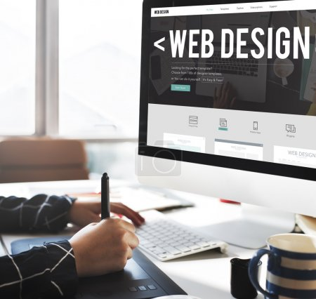 computer with Web Design on monitor