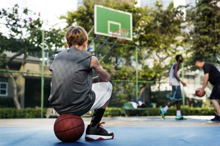 Boy sitting on the ball