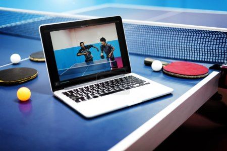 opened laptop on ping pong table