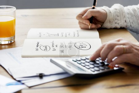 Person writing financial budget
