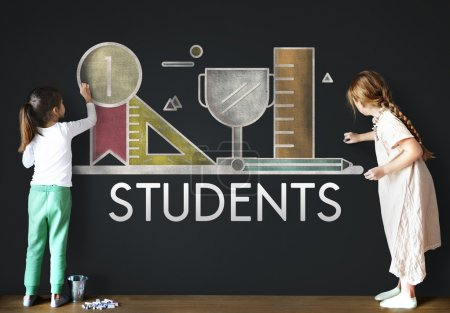 Photo for Cute Girls drawing on Blackboard, Creative Concept. Text: Students - Royalty Free Image