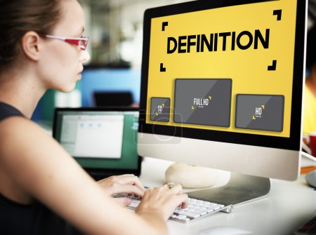 Businesswoman working on computer with Definition