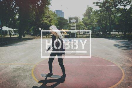 Blond girl ride on skateboard