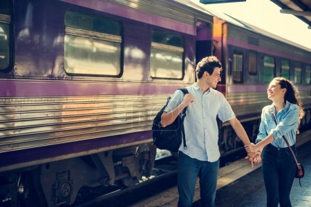 lovely couple traveling by train