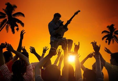 People Enjoying Music Festival
