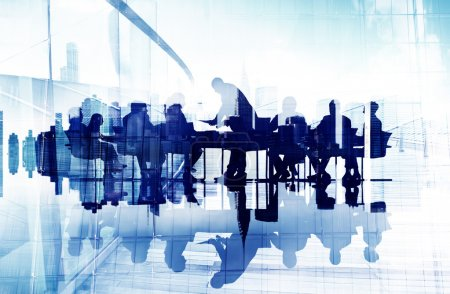 Business People's Silhouettes in Meeting