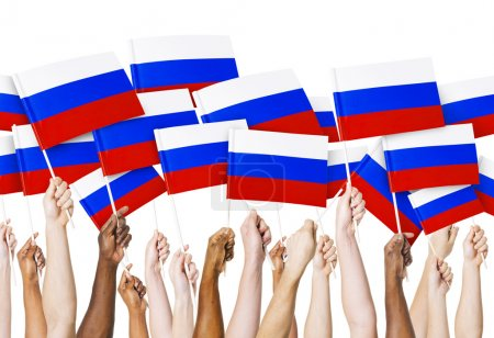 Arms holding Russian Flags