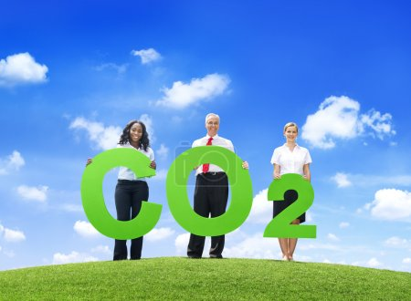 Business People Holding Carbon Dioxide