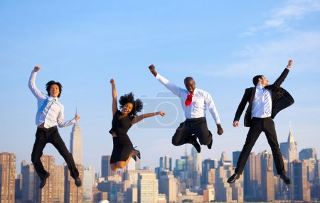 Business people jumping in New York