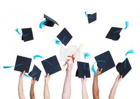 Photo for Group of Graduating Student's Hands Holding and Throwing Graduation hats as a Sign of Celebration - Royalty Free Image