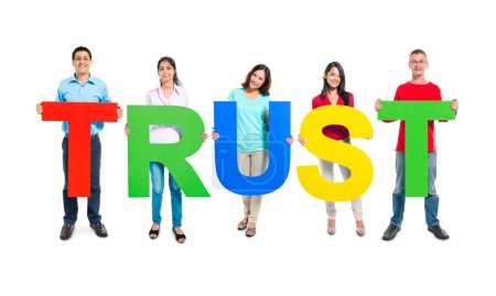 People holding 'TRUST' letters