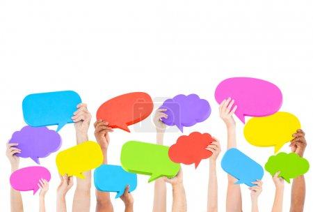 Hands holding speech bubbles