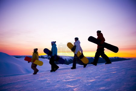 People on way to snow boarding