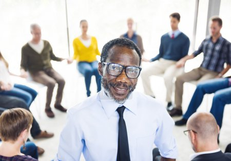 African Man in Front of Support Group