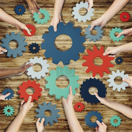 Photo for Group of Hands Holding Gears Symbol - Royalty Free Image