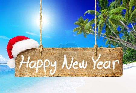 New Year board on beach