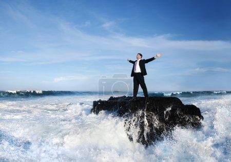 Businessman staying alone on island
