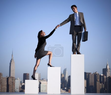 Businessman helping colleague to succeed