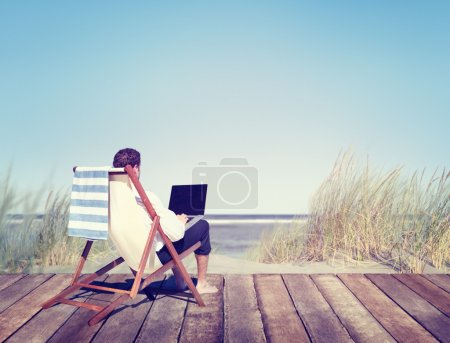 Businessman Working by Beach