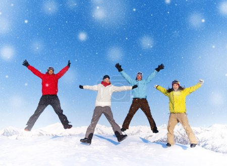 Happy people jumping in snow